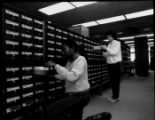 [Students using card catalogs]