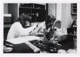 [Two female researchers]