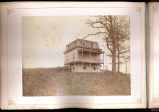 [House on hill with second floor porch]