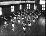 [Boys' Latin School students performing drills in gym]