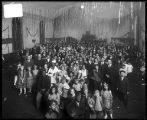 [Group portrait of costumed adults and children at a ball]