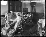 [Women working at weaving looms]