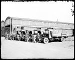 [James Lumber Co. delivery men and trucks]