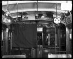 [Interior of a Birney type streetcar with curtain drawn ]