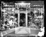 [Cummings Florist display window]