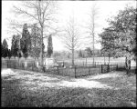 [Small fenced cemetery]