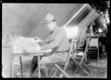 [Soldier in tent with paperwork]