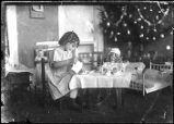 [Girl having tea party with doll]