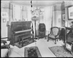 [Interior of a home with piano]