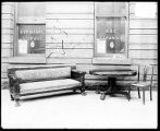 [Furniture sitting out front of Monumental Storage & Carpet Cleaning Co.]