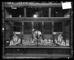 [Window of Anderson & Ireland Co. hardware store]