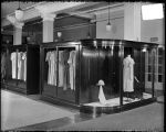 [Ladies dresses on display at department store]