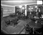[Men lounging at tables in Engineers' Club of Baltimore]