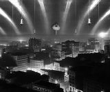 Untitled [Hanging lights and ballerina over city skyline]