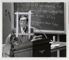 [Calvin B.T. Lee at podium in classroom]