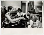 [Clare McCarthy, Donna Blakely, and Lisa Marr conduct experiments in UMBC Cancer Laboratory]