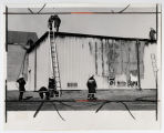 [Firefighters inspect theatre building after UMBC Student Union fire, 1974]