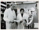 [John B. Hays and Richard E. Wolf, Jr. in laboratory, 1981]