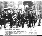 Charles Ponzi (cane in hand) leaving Federal Court Boston, after his arrest
